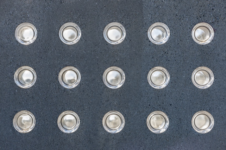 foci: Round lights embedded in a wall of gray marble Stock Photo