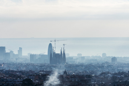 Panoramic views of Barcelona at sunrise, Catalonia, Spain. In the image highlights the Sagrada Familia Stock Photo