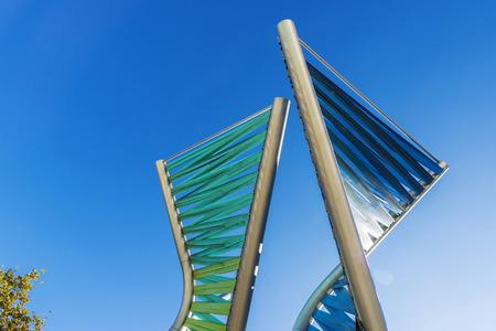 urban scene: Barcelona, Spain - October 31, 2015: Sculpture spiral to provide shade in a park in Barcelona, Catalonia, Spain Editorial