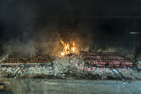 grilled meat: Grilled meat making in the kitchen of a restaurant in Spain