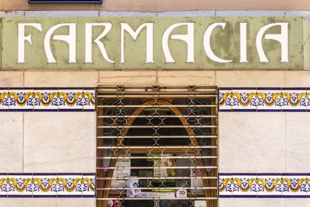 Terrassa, Spain - June 6, 2015:  Business sign Modernist of a facade of pharmacy