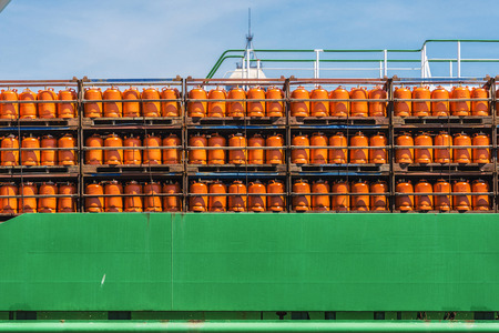 Barcelona, Spain - May 2, 2015: Butane cylinders Repsol brand stored in a boat in the port of Barcelona