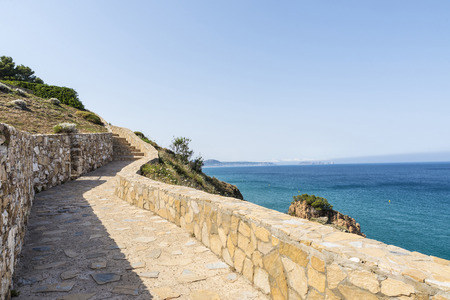 costa brava: Parapet walk with the Medes Islands in the background on the Costa Brava, Girona, Catalonia, Spain