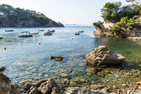 Boats moored on the beach of Sa Riera in the Costa Brava, Catalonia, Spain. Stock Photo