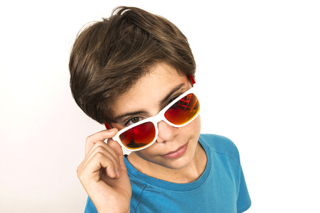 beautiful boys: Portrait of young boy with sunglasses looking at camera isolated on white background Stock Photo