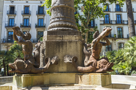 newts: Iron statue of newts playing a horn in the old town of Barcelona, Catalonia, Spain Stock Photo