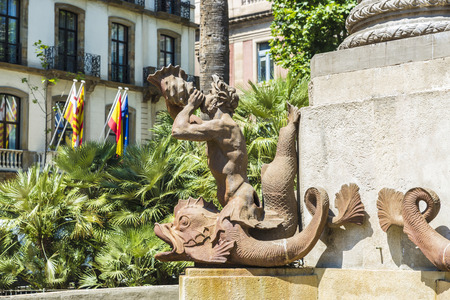 newt: Iron statue of newt playing a horn in the old town of Barcelona, Catalonia, Spain Stock Photo