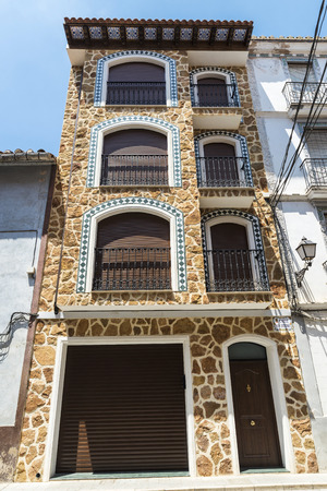 restored: Facade of a restored stone house in a village of Spain