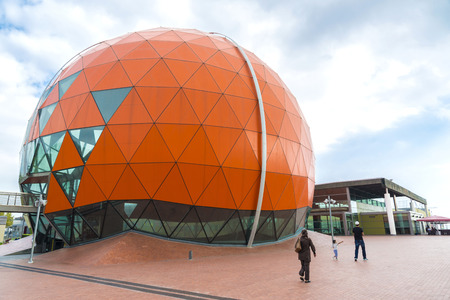 emphasizes: Badalona, Spain - November 1, 2014: Magic Badalona is a shopping and leisure center which emphasizes its large dome shaped basket ball. Muslim family walks facilities Editorial