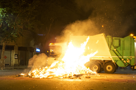 bonfire night: Bonfire night for the celebration of Sant Joan on a street while driving a garbage truck in Barcelona, Catalonia, Spain Stock Photo