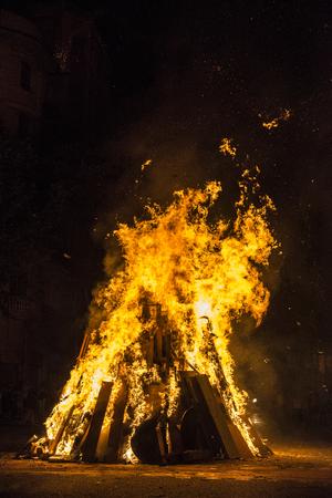 smolder: Bonfire at night on a street on asphalt
