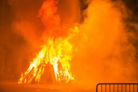 bonfire night: Bonfire night for the celebration of Sant Joan on a street in Barcelona, Catalonia, Spain
