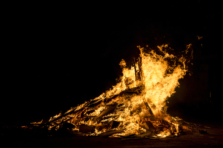 smolder: Bonfire night for the celebration of Sant Joan on a street in Barcelona, Catalonia, Spain