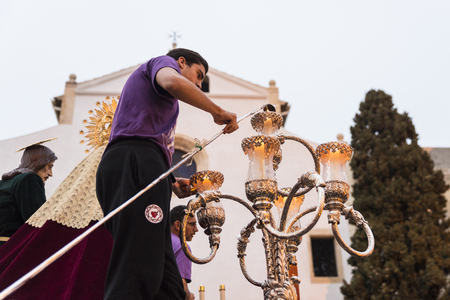holy cross: Tarragona, Spain - March 25, 2016: Easter Week, Holy Week or Semana Santa, Nazarene processions, bands of music, religious celebrations of international interest.
