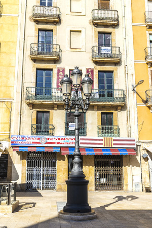 closed club: Tarragona, Spain - March 26, 2016: Classic black lamppost and bar of the Barcelona soccer supporters club in Tarragona, Catalonia, Spain