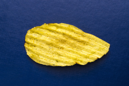 ribbed: Close-up of ribbed potato snack isolated on blue