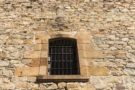 latticed: Old stone wall with a latticed window as background
