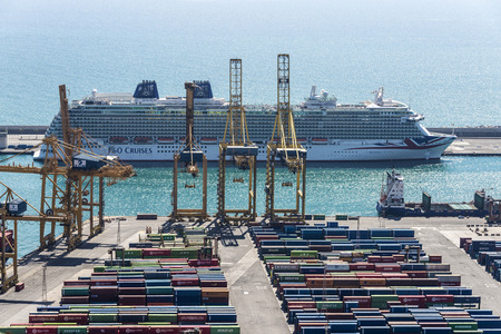 loading dock: Barcelona, Spain - April 15, 2016: View of the loading dock of goods and cruise terminal at the port of Barcelona