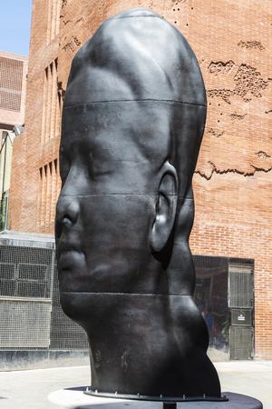 modernisme: Barcelona, Spain - April 19, 2016: Facade of the Palau de la Musica Catalana (Catalan music palace). In the foreground, a sculpture of Plensa