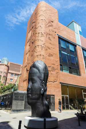 Barcelona, Spain - April 19, 2016: Facade of the Palau de la Musica Catalana (Catalan music palace). In the foreground, a sculpture of Plensa
