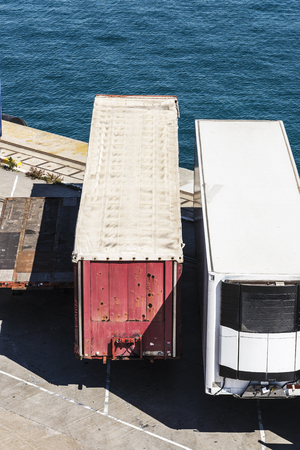 reefer: Reefer container and other types of containers waiting to board at the port of Barcelona, Catalonia, Spain