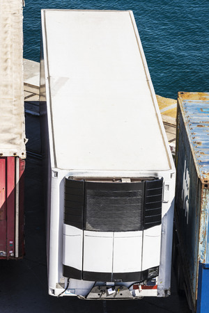 reefer: Reefer container waiting to board at the port of Barcelona, Catalonia, Spain Stock Photo