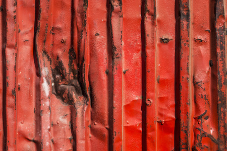 blows: Red rusty container with blows as background