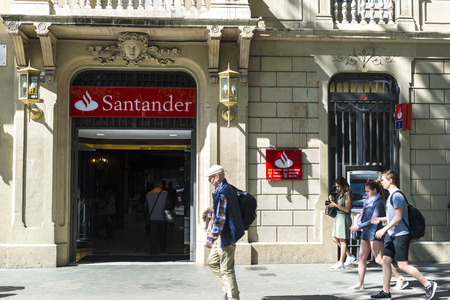 bank branch: Barcelona, Spain - May 4, 2016: Santander bank branch located on Passeig de Gracia, one of the most expensive streets in Europe.