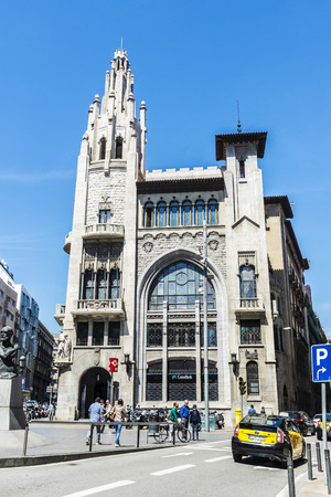 modernism: Barcelona, Spain - April 19, 2016: Former headquarters of CaixaBank. It is an Modernism style building with Gothic inspirations located in the old town of Barcelona