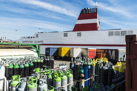 Barcelona, Spain - April 19, 2016: Propane cylinders and containers ready for transport in the port of Barcelona, Catalonia, Spain