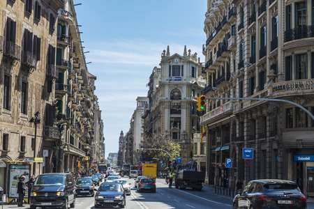Barcelona, Spain - April 19, 2016: Street called Via Laietana in the old town of Barcelona with people walking and heavy traffic in Catalonia, Spain