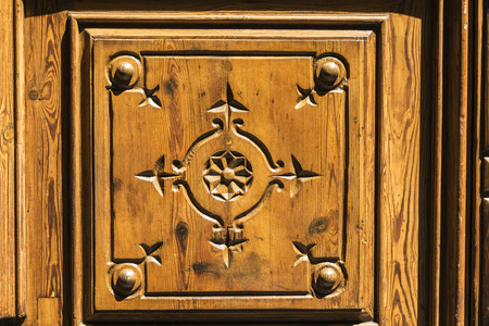 Old Wooden Door Decorated With Fleur De Lis In A Classic Building In  Barcelona, Catalonia