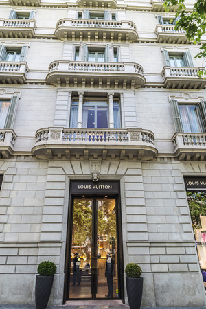 vuitton: Barcelona, Spain - May 25, 2016: Louis Vuitton shop located on Passeig de Gracia, one of the most expensive streets in Europe.