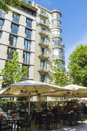 modernism: Barcelona, Spain - May 25, 2016: Terrace of a bar and a residential building of Modernism style in Barcelona, Catalonia, Spain Editorial