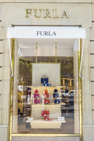 upper class: Barcelona, Spain - May 25, 2016: Furla shop located on Passeig de Gracia, one of the most expensive streets in Europe.