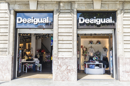upper class: Barcelona, Spain - May 25, 2016: Desigual shop located on Passeig de Gracia, one of the most expensive streets in Europe. Editorial