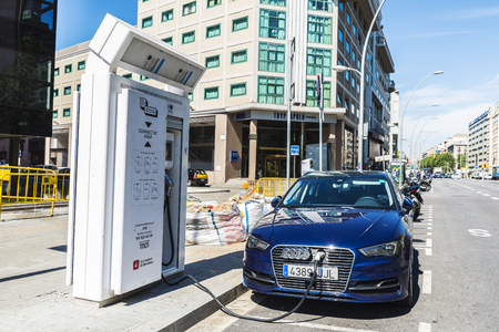 recharging: Barcelona, Spain - June 21, 2016: Electric or hybrid car of the Audi brand recharging the battery in a charging point on the street. Editorial