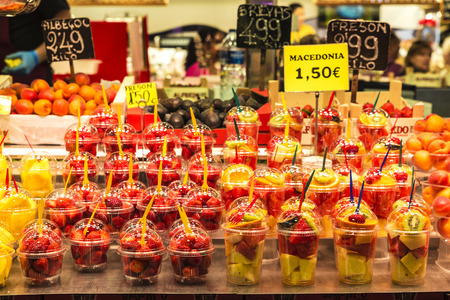boqueria: Barcelona, Spain - June 14, 2016: Fruit stand with smoothies ready to take on the market of La Boqueria in Barcelona, Catalonia, Spain