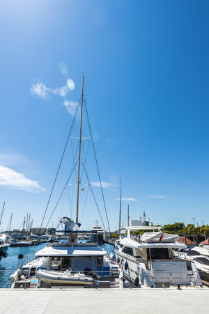Barcelona, Spain - June 21, 2016: Yachts and sailboats moored in the marina called Port Vell of Barcelona, Catalonia, Spain