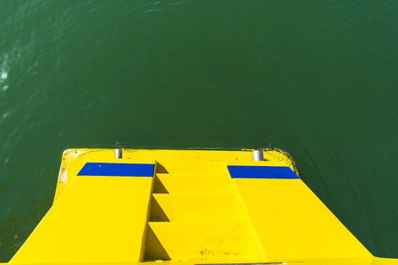 stern: Yellow stern with stairs of a boat