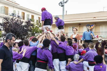 traditional climbing: Estartit, Spain - June 24, 2016: Exhibition of a colla castellers during a popular festival in Estartit located in the Costa Brava, Girona, Catalonia, Spain