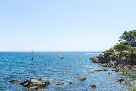 bather: Overview of La Fosca beach with bathers and boats in Costa Brava, Catalonia, Spain
