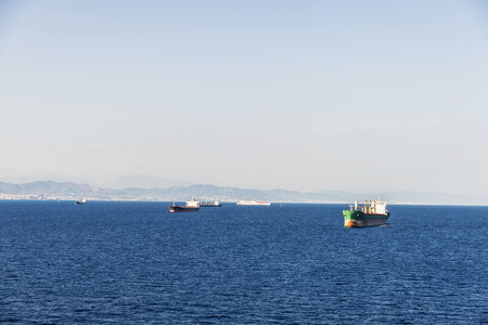 merchant: Tanker ship and other vessels sailing the Mediterranean sea near Barcelona