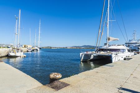Catamaran, yachts and sailboats docked at the marina in Olbia, Sardinia, Italy