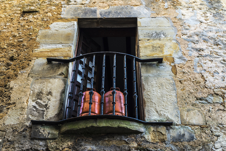 butane: Balcony with two butane gas cylinders of a typical house of the medieval village of Santillana del Mar in Cantabria, Spain Stock Photo