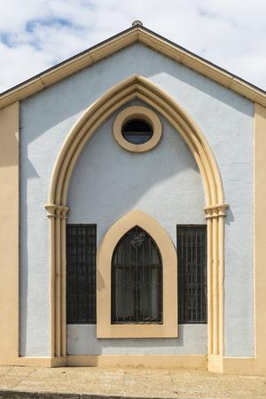 santa maria: Window of the neo-gothic facade of the Abbey of Santa Maria de Viaceli in Cobreces, Cantabria, Spain Stock Photo