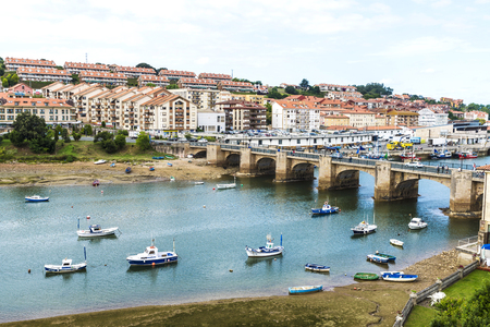 San Vicente de la Barquera, Spain - August 10, 2016: Overview of fishing boats in the harbor in the village of San Vicente de la Barquera in Cantabria, Spain