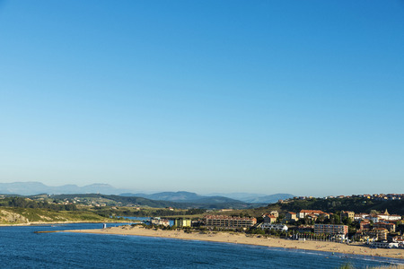 bather: Suances beach with people bathing in the Atlantic Ocean in Cantabria, Spain Stock Photo