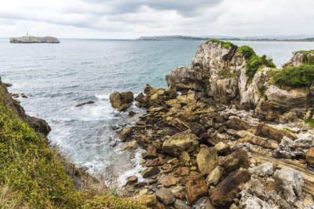 rocky coastline: Rocky coastline along cliffs in Santander, Cantabria, Spain Stock Photo
