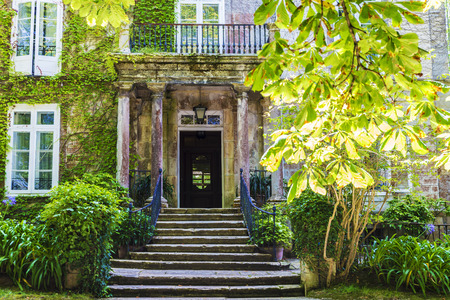 Entrance with columns of an old mansion with garden in Spain Stock Photo